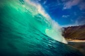 Bright colorful sea with curling wave