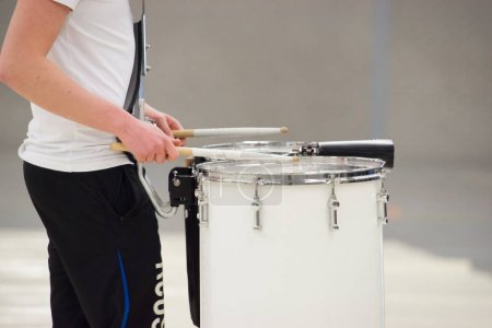Drummer Playing Tenor Drums in a drum band during a show perform