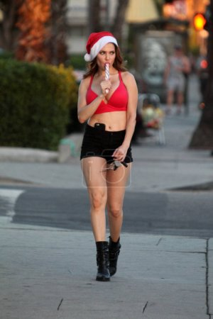 Photo for Actress Erika Jorda the Playboy TV Host is spotted Christmas shopping with candy cane, Los Angeles, CA 12-13-16 - Royalty Free Image