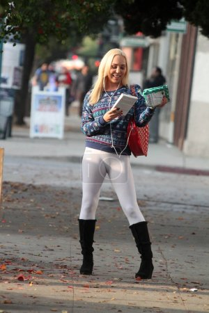 Photo for Actress Mary Carey Celebrity Rehab Star spotted out shopping while wearing tight leggings and an Ugly Christmas Sweater, North Hollywood, CA 12-20-16 - Royalty Free Image