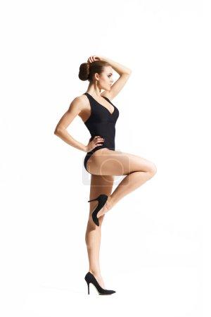 woman in black bodysuit and high heels