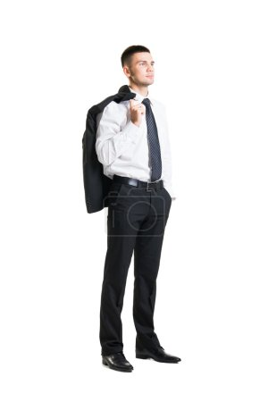 Young businessman with jacket behind his back