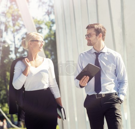 Young businesswoman and businessman couple in formal clothes