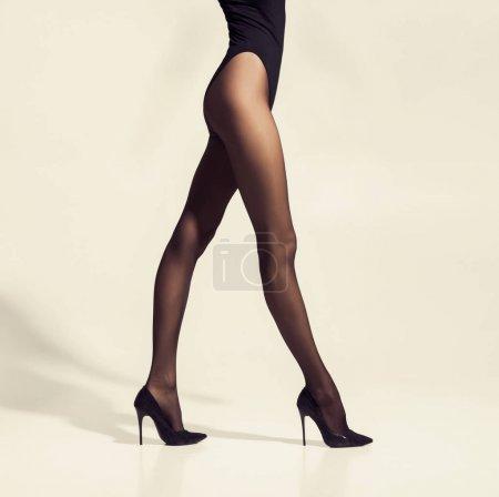 Beautiful slim woman in tights and underware