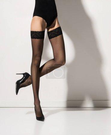 Beautiful slim woman in stockings and underware