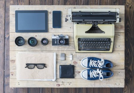 Journalist equipment on old wooden table