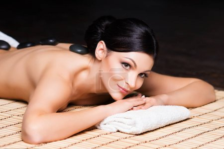 young and natural woman on spa massage
