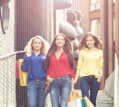 Young and happy women with shopping bags