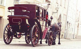 orse and beautiful old carriage