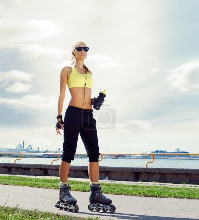 Young and fit woman rollerblading on skates