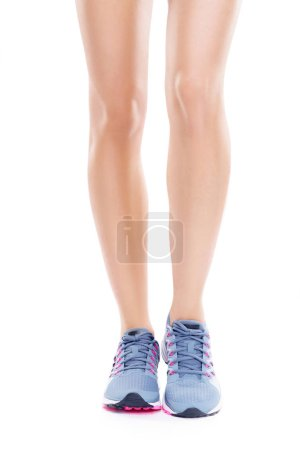 female legs wearing running shoes