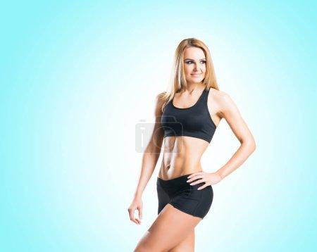 Fit young woman in black sportswear