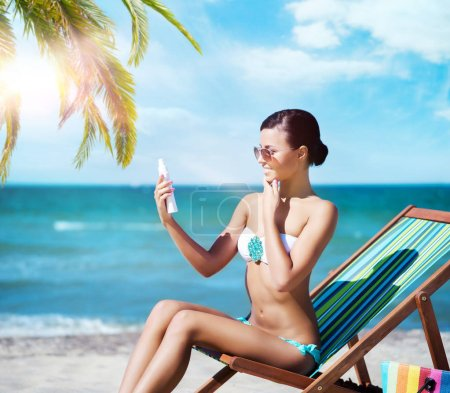 beautiful woman relaxing on summer beach