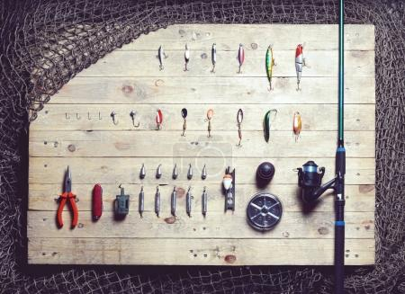 fishing tackle on wooden planks