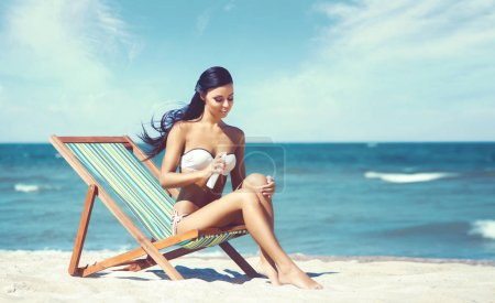 Beautiful woman relaxing on summer beach