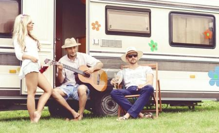 happy friends at camper trailer
