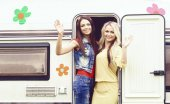 young women at camper trailer