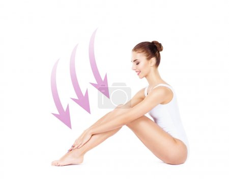 Photo for Beautiful, young and sporty woman with arrows near her body isolated on white background. Health, sport, fitness, nutrition, weight loss, diet, cellulite removal, liposuction, healthy lifestyle concept - Royalty Free Image