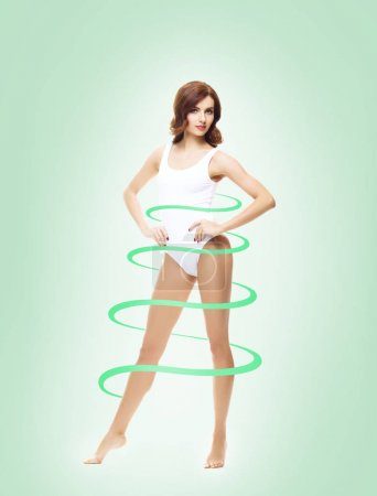 spiral around slim and beautiful body of young woman in lingerie. Weight loss, sports, exercising, water balance, healthy nutrition concept