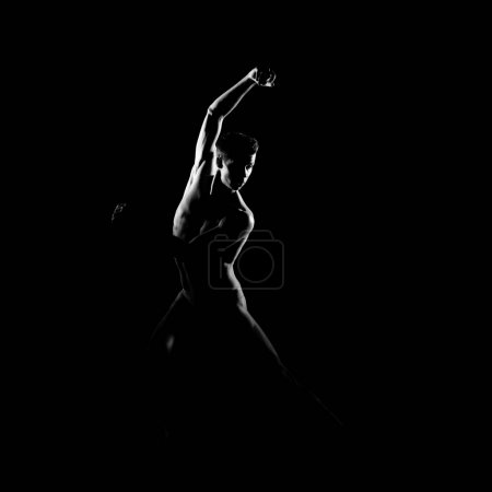 Black and white silhouette trace of male ballet dancer.