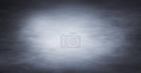 Abstract texture of the blue smoke over black background