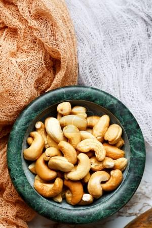 Roasted cashew nuts close-up in a bowl