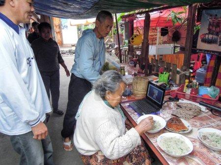 Grandmother talking to her granddaughter through Skype at Luang