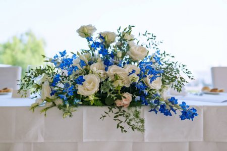 Floral decoration on wedding luxury table.