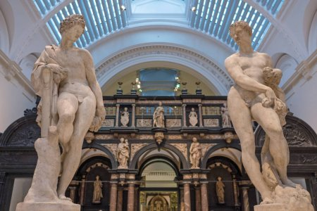 LONDON, UK - CIRCA JANUARY, 2018: Statues inside Victoria and Albert Museum hall. V&A Museum is the world's largest museum of decorative and design arts.