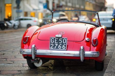 MILAN, ITALY - CIRCA SEPTEMBER 2016: MG MGA vintage red car parked on the street. Rear view. MG Car is a British sports car manufacturer begun in the 1920s.
