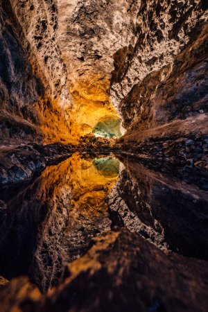Green Cave - Cueva de los Verdes, an amazing lava tube and tourist attraction on Lanzarote island, Spain. The water reflection causes an optical illusion.