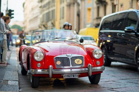 MILAN, ITALY - CIRCA SEPTEMBER 2016: MG MGA vintage red car parked on the street. Front view. MG Car is a British sports car manufacturer begun in the 1920s.