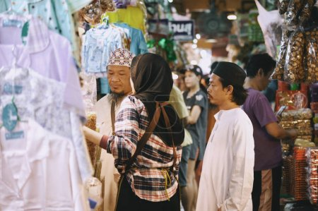 Unidentified tourists are shopping at Kim Yong market