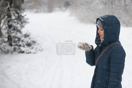 Woman walking in winter park
