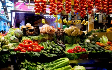 Shopfront with various fresh vegetables at covered street market, Barcelona, Spain