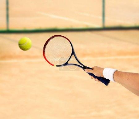 Hitting a tennis ball