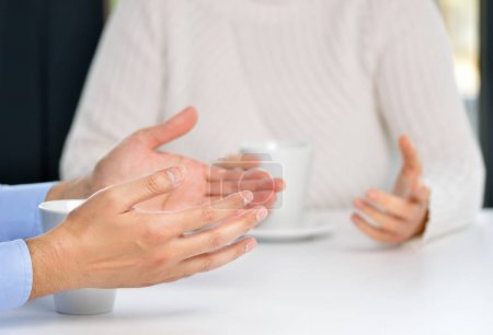 Photo for Two friends hands talking in a bar - Royalty Free Image