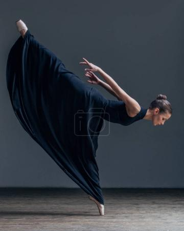 ballerina wearing long black skirt