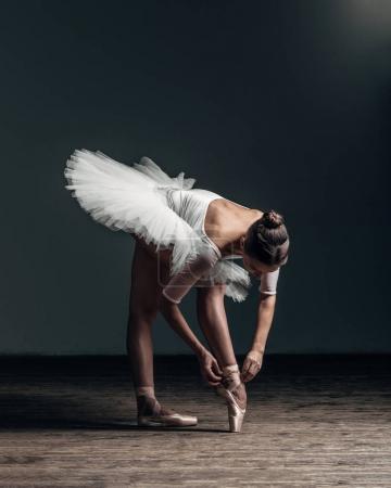 ballerina dancing wearing tutu in studio