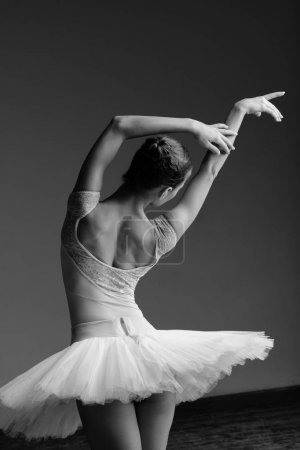 ballerina dancing wearing tutu in studio
