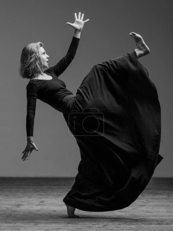 flexible woman dancing in studio