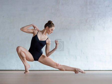 woman ballet dancer posing in studio