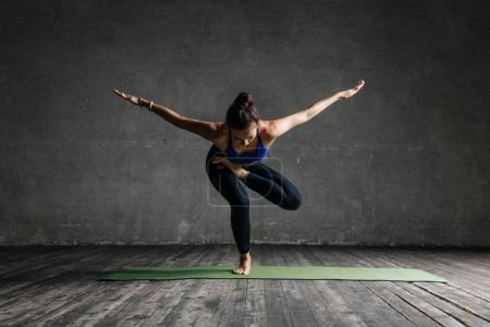 beautiful yoga female posing in studio