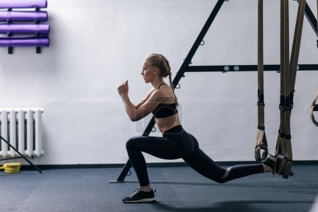 woman  doing TRX exercise