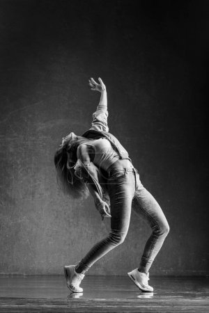 Photo for Young beautiful woman dancer posing in studio - Royalty Free Image