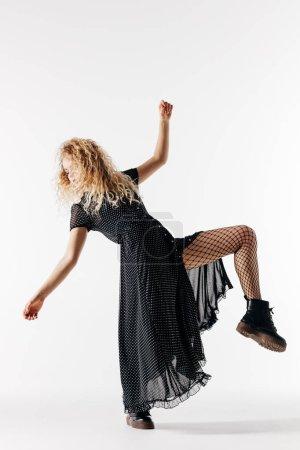 Young beautiful woman dancer posing in studio...