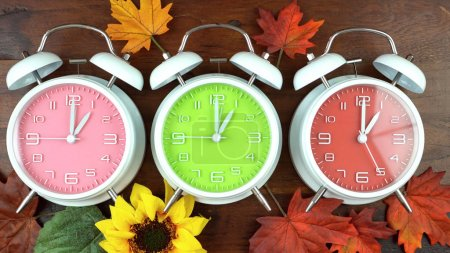 Photo for Turning the clocks back one hour for Autumn Fall daylight saving time. - Royalty Free Image