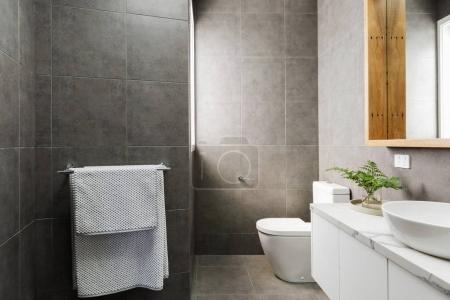 Charcoal grey bathroom with marble benctop