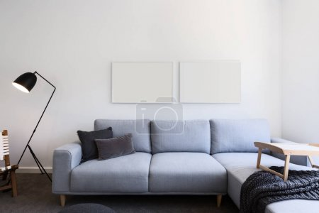 Pale blue linen sofa in a living room