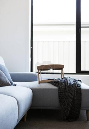 Light blue sofa with tray table